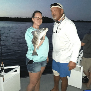 Catching Black Drum on our fishing charter tour.