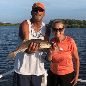Catching fish on our fishing charter tour.